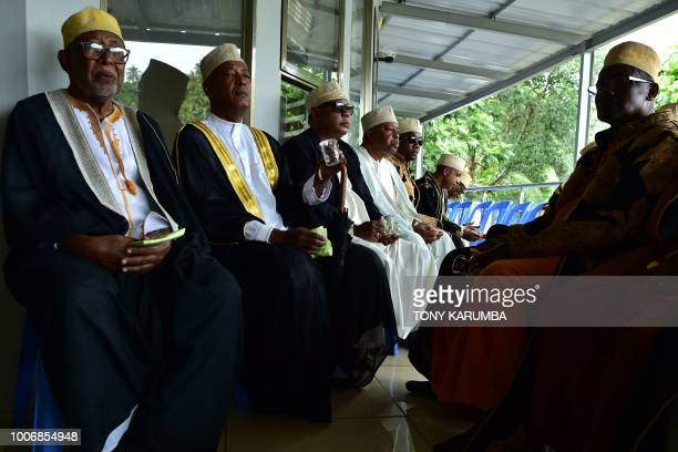 Men in their ceremonial garbs are pictured at a traditional wedding ceremony in Moroni July 28 capital of the volcanic Comoros archipelago off...