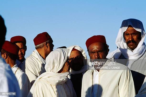 Men in traditional clothes Festival of the Sahara in Douz Tunisia