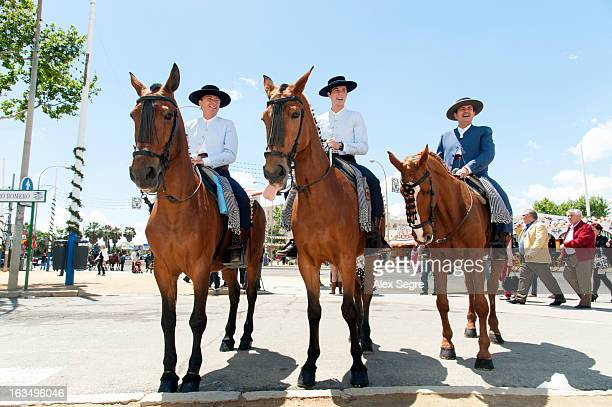 Men in traditional costume on horses during the Seville April Fair or the Feria de abril de Sevilla, Spain