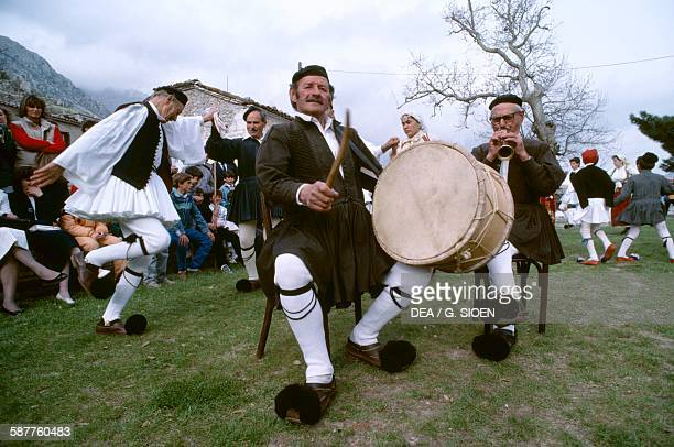 Men in traditional costume playing music during the Easter celebrations Arachova Boeotia Greece