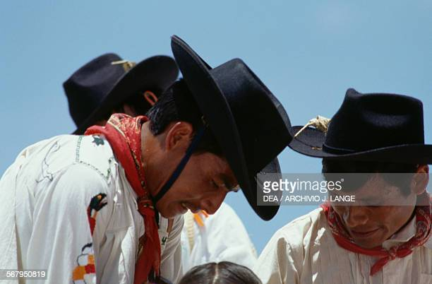 Men in traditional costumes during the celebrations at the Guelaguetza festival Oaxaca Mexico