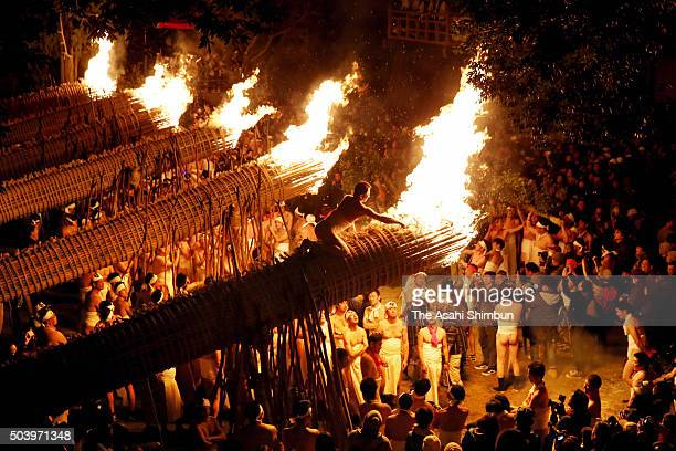 Men in traditional 'shimekomi' loincloths light six 13metrelong giant torches during the 'Oniyo' fire festival at Daizenji Tamataregu Shrine on...