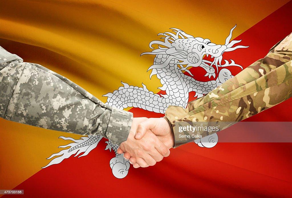 Men In Uniform Shaking Hands With Flag Bhutan Stock Photo