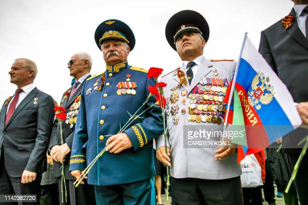 Men in uniforms attend an event to commemorate the 74th anniversary of the victory over Nazi Germany at the Soviet Memorial in Berlin's Treptower...