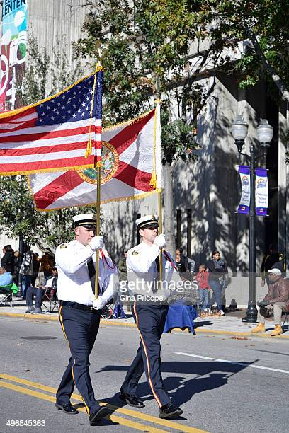 Men in uniforms with flags parade for the Martin Luther King Day in Orlando, Florida.