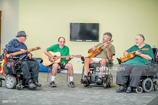men in wheelchairs playing music - recreational pursuit stock pictures, royalty-free photos & images