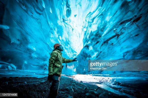 men inside ice cave - nature reserve stock pictures, royalty-free photos & images