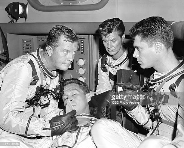 Men Into Space episode 'Moon Landing' featuring William Lundigan as Col Edward McCauley tending to a dying Dr Russ Russell Joe Maross as Maj Patrick...