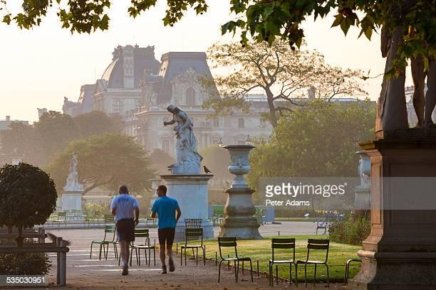 Men jogging in Tuileries Gardens, Paris, France