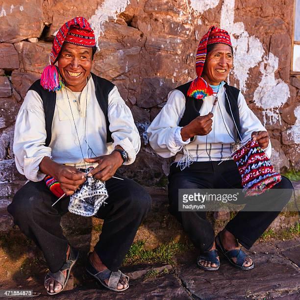 Men knitting on Taquile Island, Lake Titicaca, Peru
