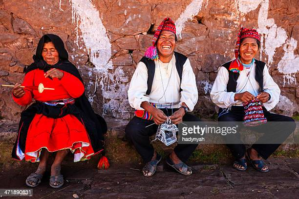 men knitting on taquile island, lake titicaca, peru - indigenous peoples of south america stock pictures, royalty-free photos & images