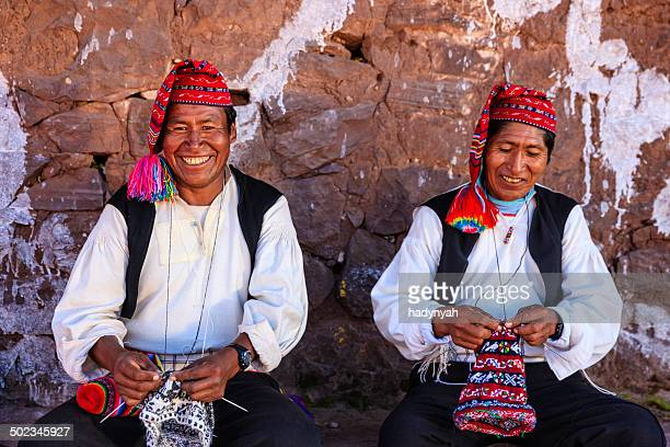men knitting on taquile island, lake titicaca, peru - traditional clothing stock pictures, royalty-free photos & images