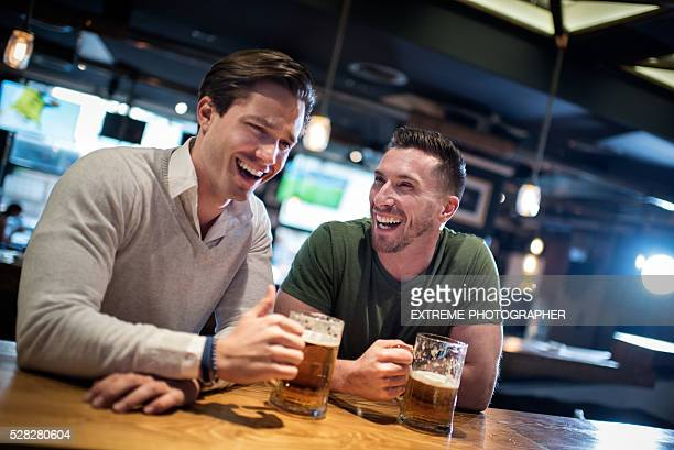 Men laughing in the pub