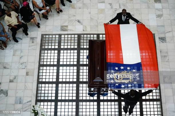 Men lay a Georgia state flag over the body of civil rights leader C.T. Vivian as he lies in state in the Georgia Capitol building on July 22, 2020 in...