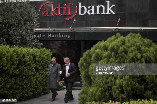 Men leave a branch of Turkish bank aktifbank on December 1 2017 in Istanbul Turkey The trial of Mr Reza Zarrab an IranianTurk who ran a foreign...