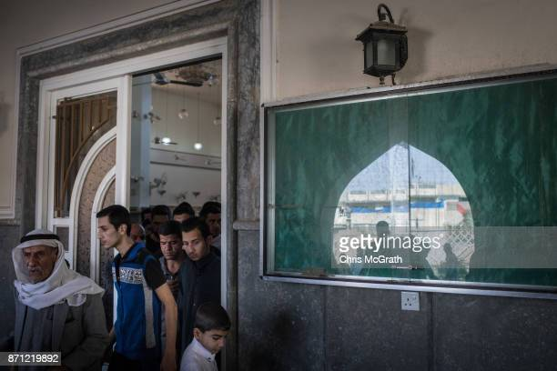Men leave a mosque after attending Friday prayers in West Mosul on November 3 2017 in Mosul Iraq Five months after Mosul Iraq's secondlargest city...