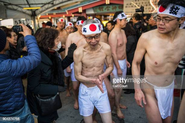 Men leave after taking part in a purification ritual that involved pouring icecold water over themselves at Kanda Myojin shrine on January 13 2018 in...