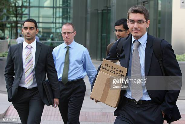 Men leave Lehman Brothers' Canary Wharf office on September 15, 2008 in London, England. The fourth largest American investment bank has announced...