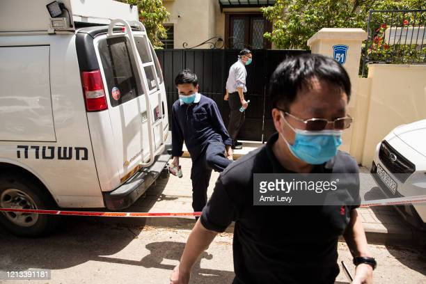 Men leave the house of China's Ambassador to Israel Du Wei, after he was found dead in his home on May 17, 2020 in Herzliya, Israel. Du Wei was...