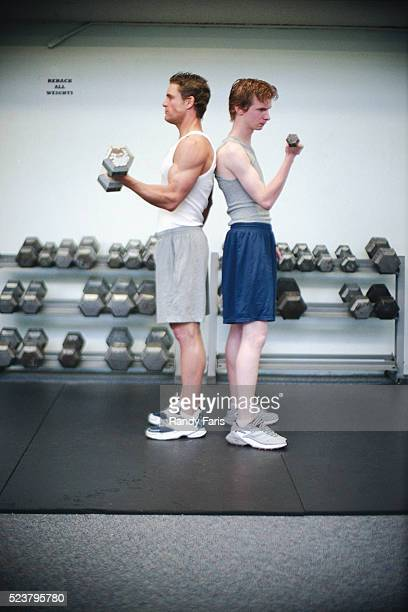 Men Lifting Weights in Unison