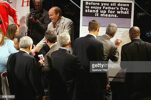 Men line up to sign a declaration against family violence that affects 1 in 3 American women June 1, 2004 in New York City. The Family Violence...