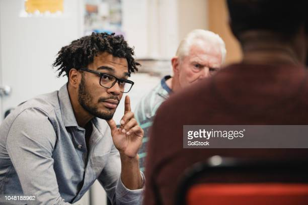 men listening in a support group - community centre stock pictures, royalty-free photos & images