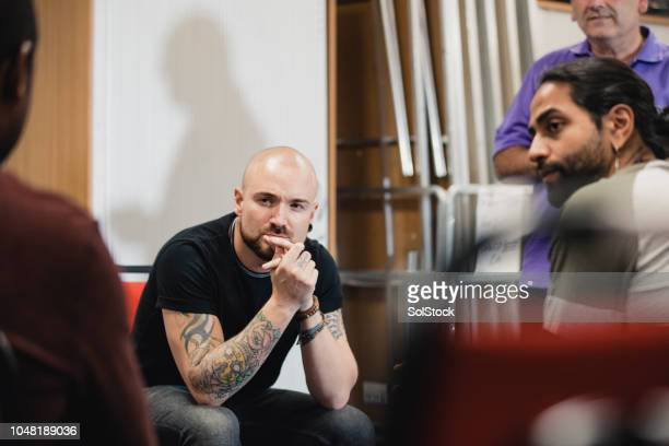 men listening in a support group - social services stock photos and pictures