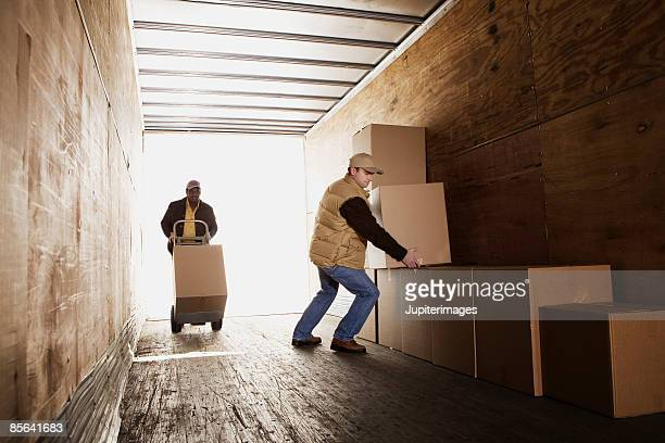 Men loading boxes onto truck