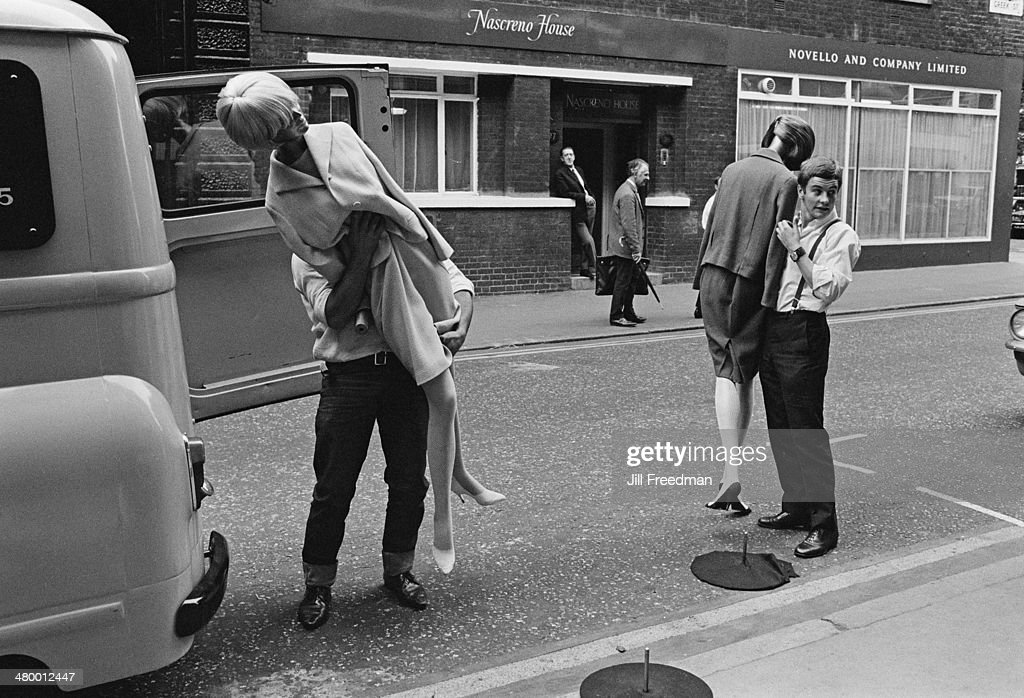 Men loading shop mannequins into a van outside Nascreno House in Soho, London, England, 1969.