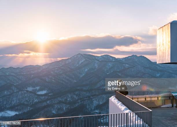 a men look sunset. sapporo city view from the top of mt.moiwa , japan. - sapporo - fotografias e filmes do acervo