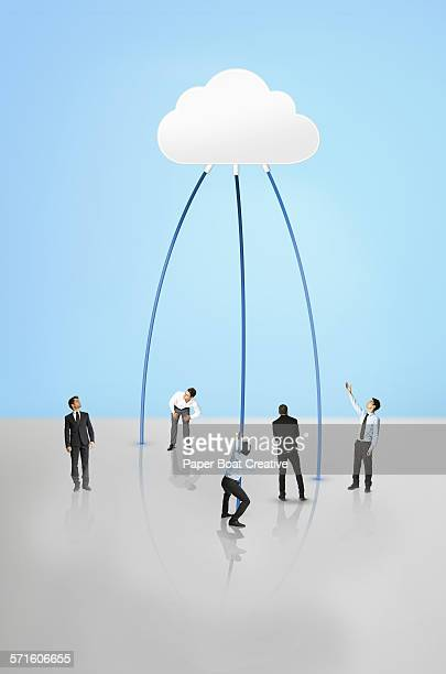 Men looking at a giant cloud data storage center