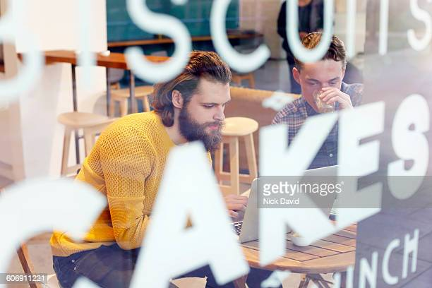2 men looking at a laptop