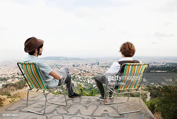 Men looking at city view