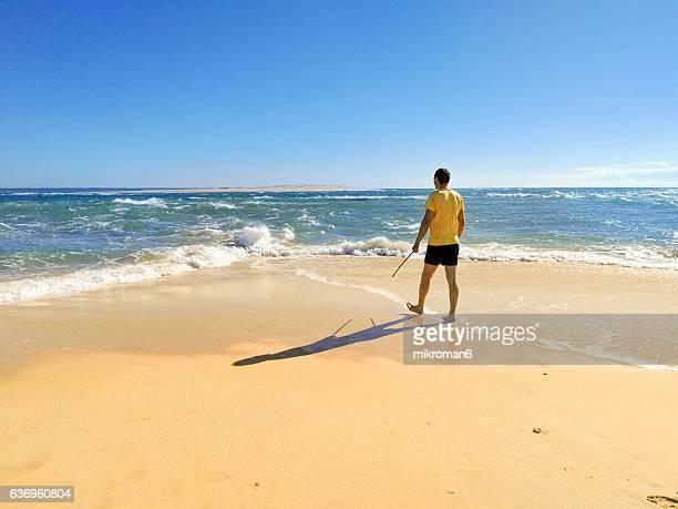 Men looking out to the beach (Praia de Faro)