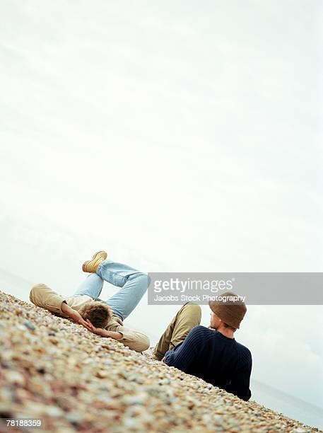 Men lounging outdoors