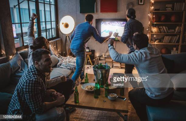 men love sport - home after party stock pictures, royalty-free photos & images