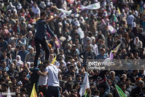 Men make a human tower as they celebrate Nowruz festivities on March 21 2018 in Diyarbakor Turkey Nowruz meaning new day is widely celebrated by...
