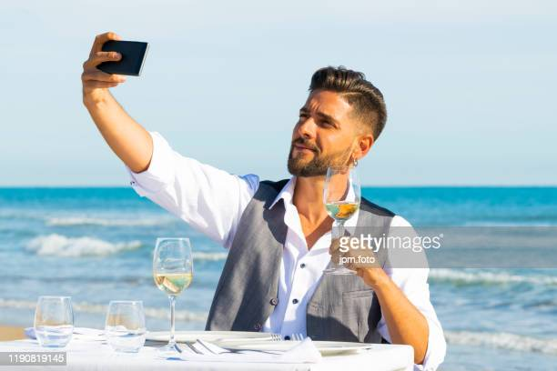 men make selfie beach with glass