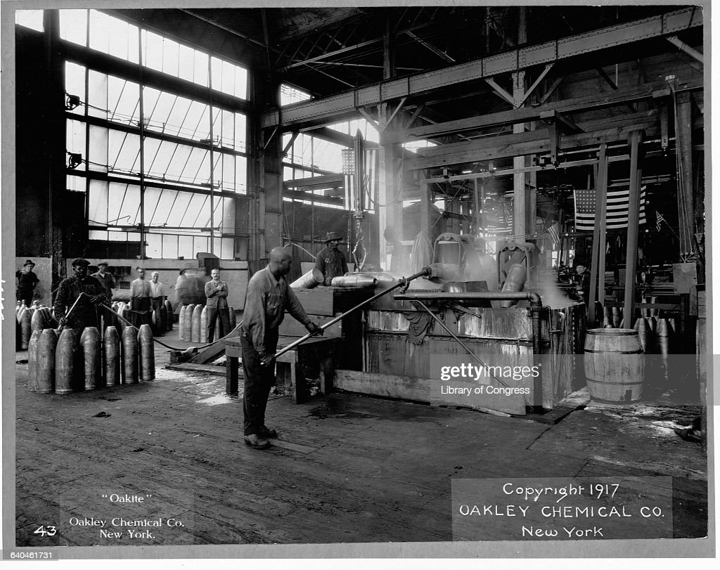 Men make munitions for World War I on the factory floor of Oakley Chemical Company.