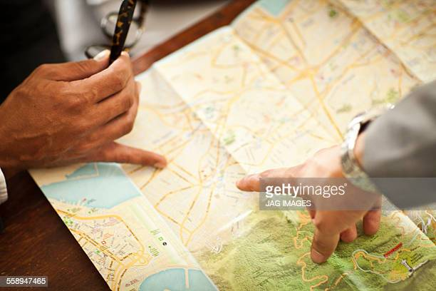 Men map-reading, view of hands