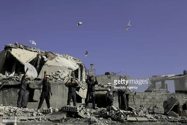 Men members of Syrian civil defense organization White Helmets let a white pigeon to fly for people who lost his life in chemical attack that in the...