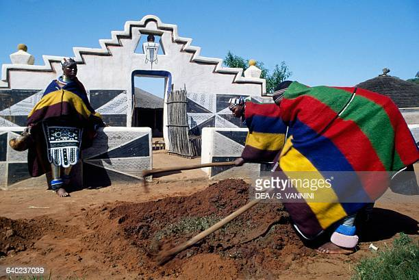 Men mixing clay in a Ndebele village South Africa