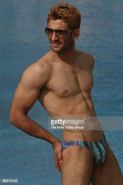 A men model displays swimwear designed by fashion designer Jattin Kochhar at The Grand New Delhi