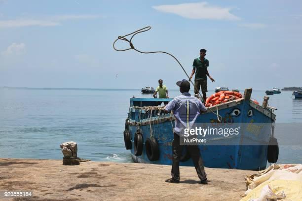 Men moor a boat at the harbour on Nainativu Island in the Jaffna region of Sri Lanka