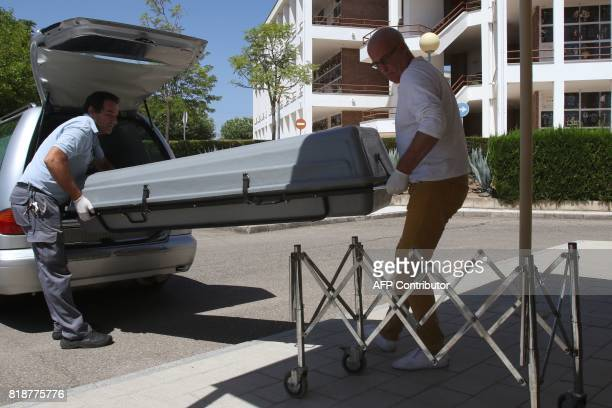 Men move a casket containg the body of the former head of Spanish bank Caja Madrid Miguel Blesa on arrival to Forensic Institute in Cordoba on July...