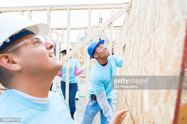 Men move board while building charity home