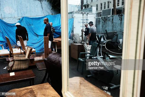 Men move furniture at a sale run by the American Rescue Workers in the struggling city of Williamsport which has recently seen an epidemic of opioid...