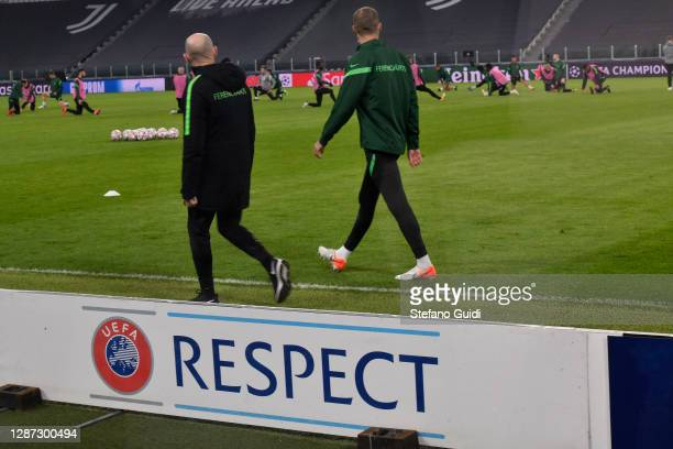 Men next to a UEFA logo that says Respect during of training session ahead of the UEFA Champions League Group G stage match between Ferencvaros...