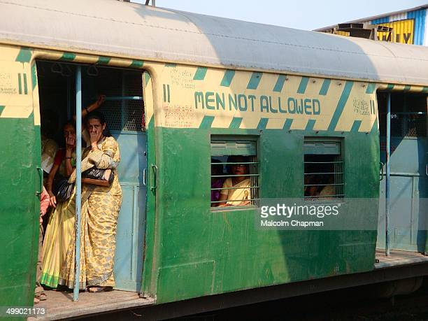 Men not allowed. A ladies only carriage on a Kolkata commuter train on the approach to Howrah station.