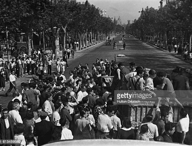 Men of all ages climb into trucks on the Rambla in Barcelona to be taken to recruiting centres to sign up to fight for the republican government...